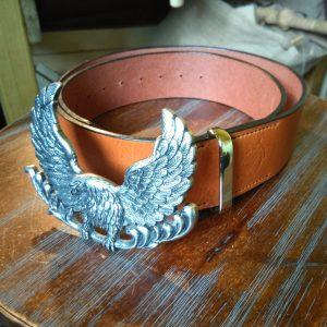 A belt in tan using a salvaged eagle buckle