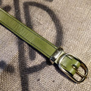 Green belt with full length black stitch, brass metalwork and black edging
