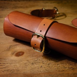 Tool roll in tan with brass metalwork for mounting to motorbike