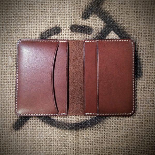 Tailor wallet in dark brown with cream stitching (open)