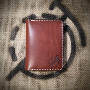 Tailor wallet in dark brown with cream stitching (closed)