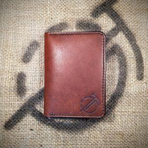 Tailor wallet in dark brown with dark brown stitching (closed)