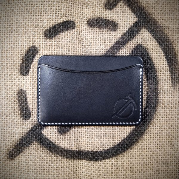 Tinker wallet in black with white stitching (front)