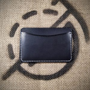 Tinker wallet in black with white stitching (back)