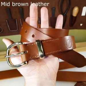 Tunner belt in mid brown with light brown stitching and brass buckle 1